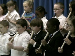 Lane and friends playing recorders in their spring concert